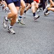 Running marathon on city street - Stock Photo