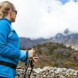 Woman hiking in Himalaya Mountains — Stock Photo #11357552