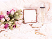Beautiful bridal flowers with banner add and wedding rings — Stock Photo