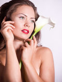 Nude woman with white calla lily — Stock Photo