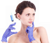 Beautiful woman gets an injection in her face isolated — Stock Photo