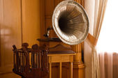 Old gramophone in a vintage room — Stock Photo