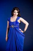 Beautiful young woman in blue dress — Stock Photo