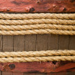 Old texture of wooden boards with vintage ship rope — Stock Photo