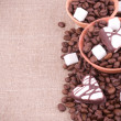 Coffee beans with sugar on sacking background — Стоковая фотография