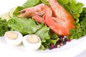 Tasty fried prawn food with salad and eggs — Stock Photo