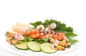 Raw cocktail of seafood with vegetables — Stock Photo