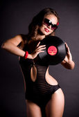Sexy young woman in retro style with vinyl plate — Stock Photo