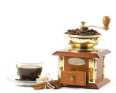 Coffee cup and coffee mill — Stock Photo