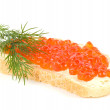 Red caviar with bread and butter on the white background — Stock Photo #11438855