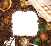 Coffee beans and sweetnesses in frame — Stock Photo