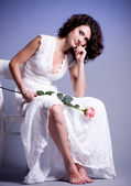 Young woman in bridal dress with rose — Stock Photo