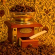 Vintage coffee grinder with coffee beans — Stock Photo