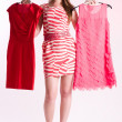 Happy young shopping woman with new dresses — Stock Photo