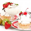 Dessert - sweet cake with strawberry and cherry on a plate on background — ストック写真