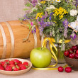 Flowers, barrel, apple, strawberry and cherry — Stock Photo