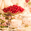 Vintage tea in elegant tableware with flowers — Stockfoto