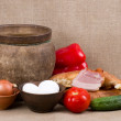 Clay pot, vegetables, oil and meat pork — Stock Photo