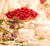 Vintage tea in elegant tableware with flowers — Stock Photo