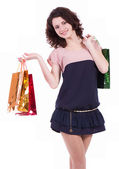 Happy young woman with shopping bags isolated on a white background — Stock Photo