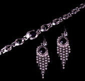 Jewelry on black background — Stock Photo