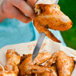 Chef cook preparing grilled chicken wings — Stock Photo