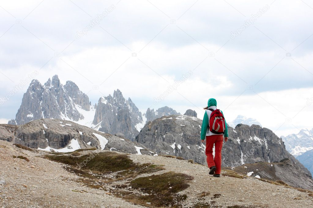 Hiker to go uphill at the mountains,  Alps  Stock Photo #11614553