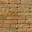 Stock Photo: Rough red brick seamlessly tileable