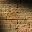 Stock Photo: Rough red brick lit diagonally