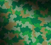 Green camouflage pattern lit diagonally — Stock Photo