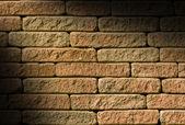 Rough red brick lit diagonally — Stock Photo