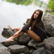 Stock Photo: Sexy young girl on stone banks of River