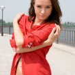 Beautiful girl in red shirt — Stock Photo