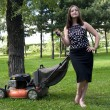 Stock Photo: Girl with lawn mower