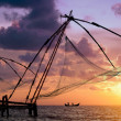 Sunset over Chinese Fishing nets in Cochin — Stock Photo #10943976