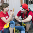 Stock Photo: WARSAW, POLAND - JUNE 16: Russifans make face painting before football match with Greece on July 16, 2012 in Warsaw, Poland. UefEuro 2012 is hosted by Poland and Ukraine.