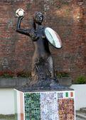 WARSAW, POLAND - JUNE 16: Siren Statue with football decorates U — Stock Photo