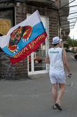 WARSAW, POLAND - JUNE 16: Russian fan with flag at Warsaw street before UEFA EURO 2012 Russia vs. Greece football match, June 16, 2012 in Warsaw, Poland — Stock Photo