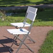 White chair in the garden — Stock fotografie