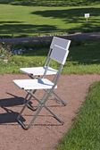 White chair in the garden — Stock Photo