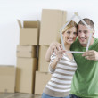 Young couple moving in new home — Stock Photo #10855331