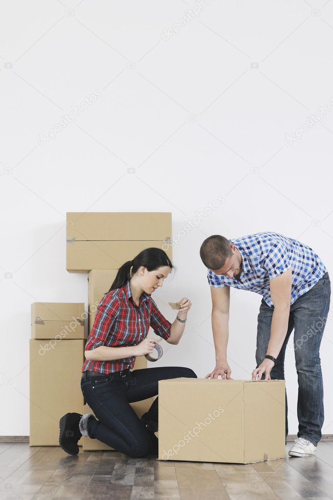 Happy Young couple moving in new home — Stock Photo #10856259