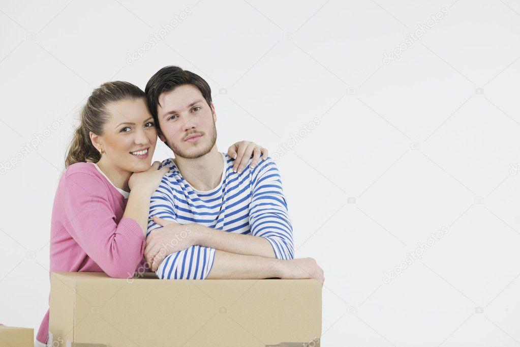 Happy Young couple moving in new home — Stock Photo #10856504