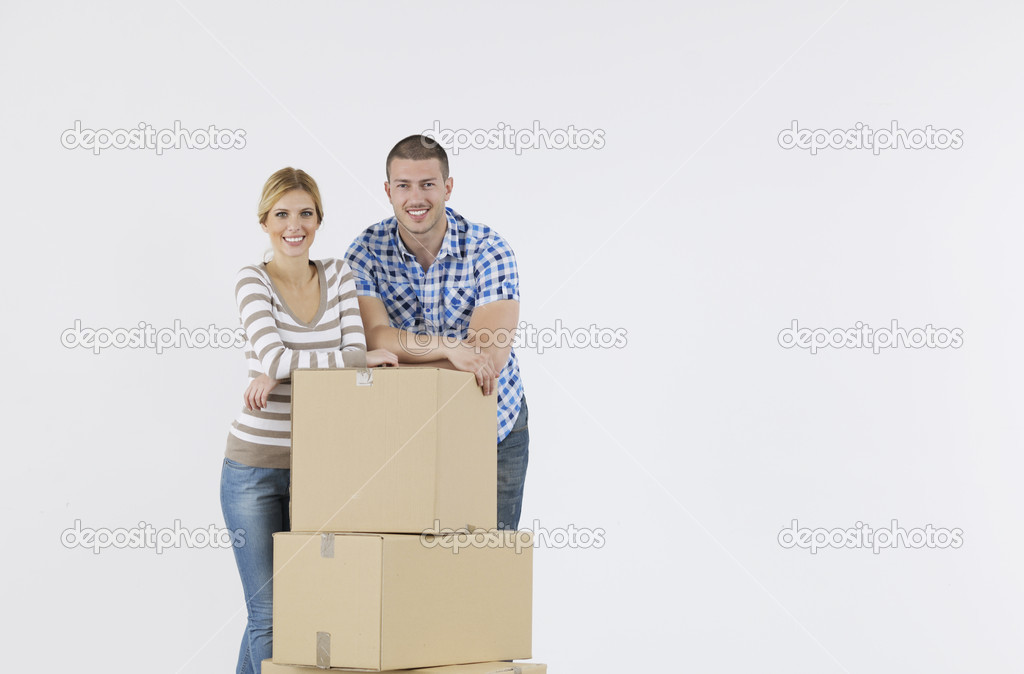 Happy Young couple moving in new home — Stock Photo #10856645