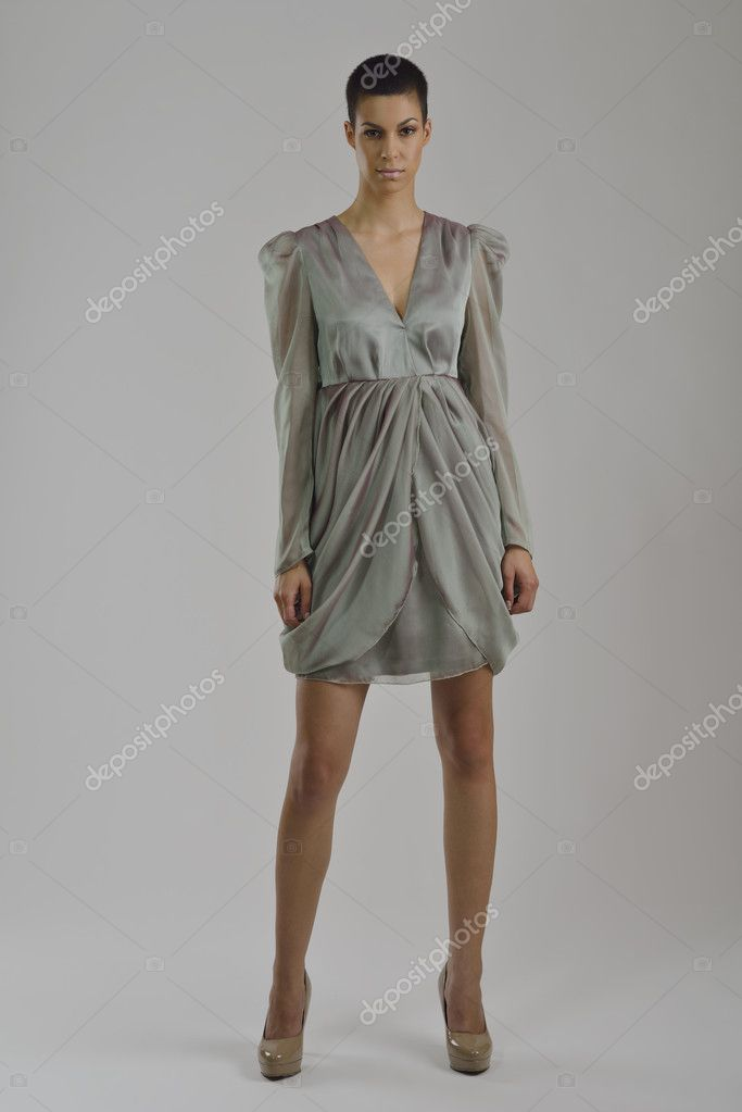 Elegant woman in  fashionable  stylish dress posing in the studio  Stock Photo #10949284