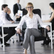 Business woman with her staff in background — Stock Photo