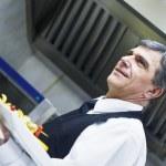 Male chef presenting food — Stock Photo #11234943