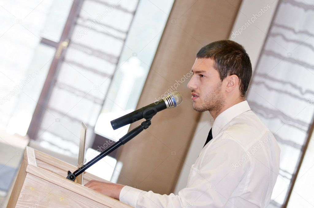 Young  male business man giving a presentation at a  meeting seminar at modern conference room  on a table board — Stock Photo #11234644