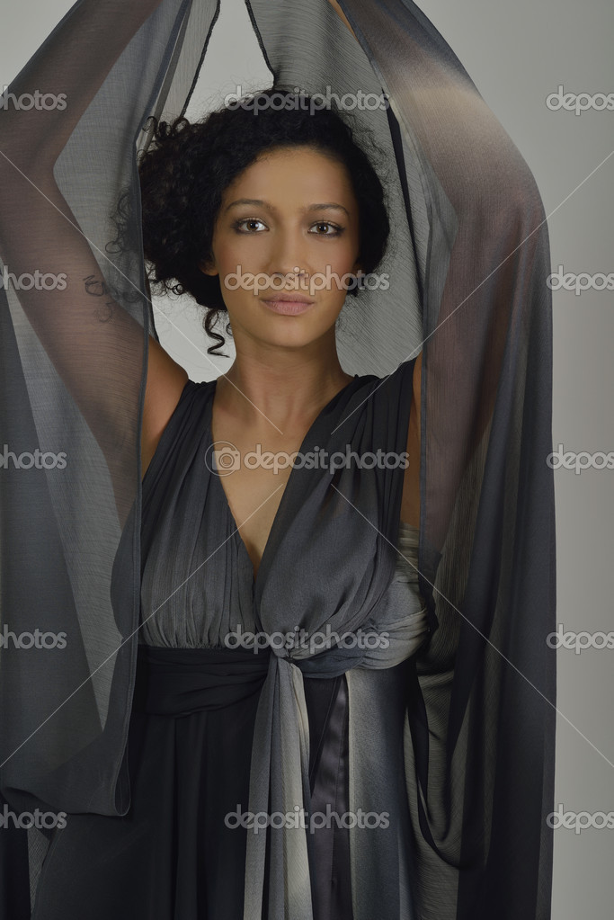 Elegant woman in  fashionable  stylish dress posing in the studio — Stock Photo #11235671