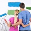 Happy couple paint wall at new home — Stock Photo #11270605